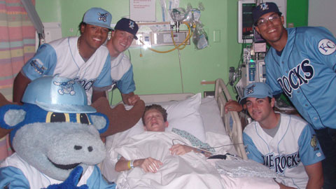 One of the many visits by Blue Rocks players and team mascot Rocky Bluewinkle to A.I. duPont Hospital included (left-to-right): Rocky, Ivor Hodgson, Buddy Baumann, Barry Bowden, Adrian Ortiz.